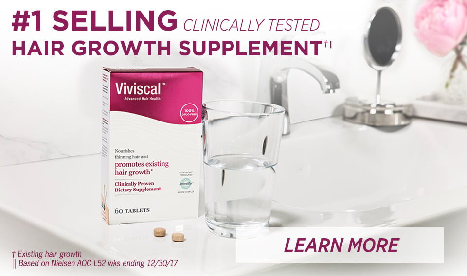 viviscal supplements on table with glass of water #1 selling clinically tested hair growth supplement learn more