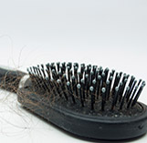 Cover thinning hair with fibers